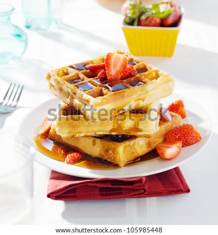 breakfast - waffles with syrup and strawberries - stock photo