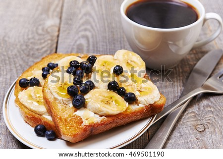 breakfast with black coffee and toast