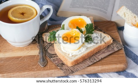 breakfast with boiled eggs and crispy toasts, closeup.