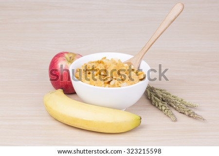 breakfast with cereal, milk and apple and banana  - stock photo