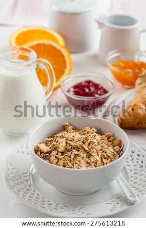 Breakfast with cereal, milk, orange juice - stock photo
