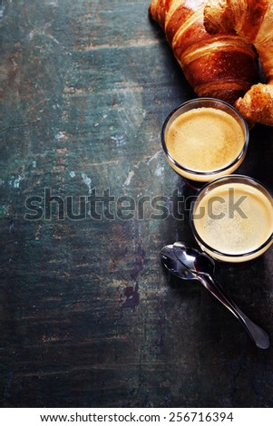 Breakfast with coffee and croissants  - stock photo