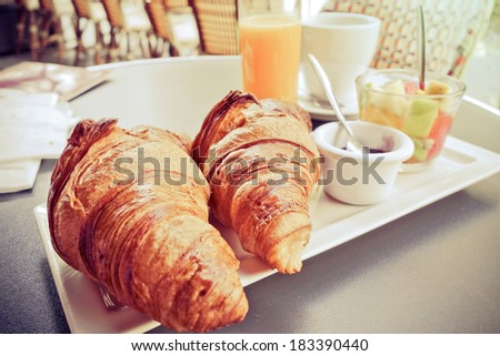 Breakfast with coffee and croissants on table - stock photo
