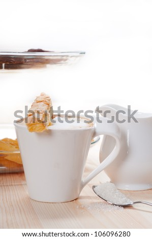 breakfast with coffee and fresh baked  pastry over a natural pine wood table - stock photo