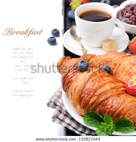 Breakfast with coffee and fresh croissants - stock photo