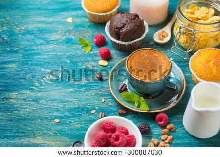 Breakfast  with coffee, berries and muffin. Food background with copyspace - stock photo