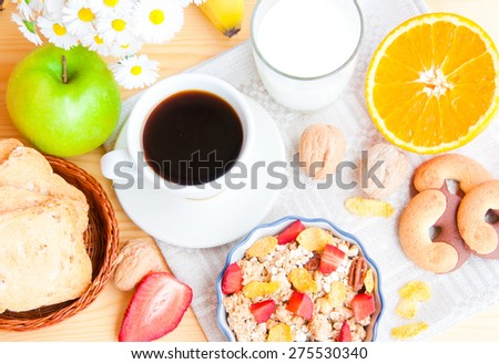 Breakfast with coffee, cereals, milk and fruit - stock photo