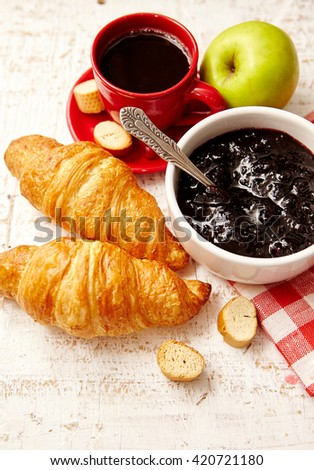 Breakfast with coffee, croissant and jam, apple and toast