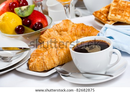 breakfast with coffee, croissants and fresh fruits - stock photo
