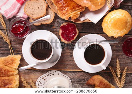 breakfast with coffee cup and pastries - stock photo