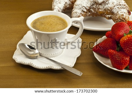 Breakfast with coffee , fresh croissants and strawberries. - stock photo