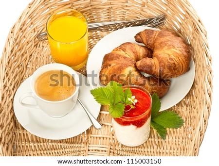 breakfast with coffee, orange juice, fresh strawberry yogurt and croissant - stock photo