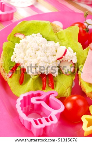 breakfast with cottage cheese for child with sheep shape sandwich - stock photo