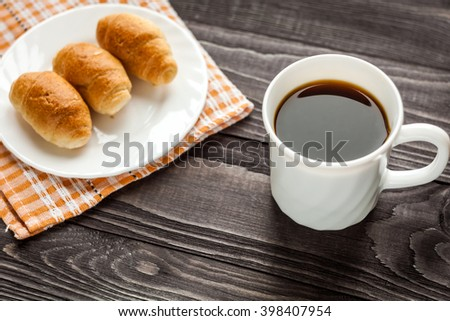 breakfast with croissant and cup of coffee  - stock photo