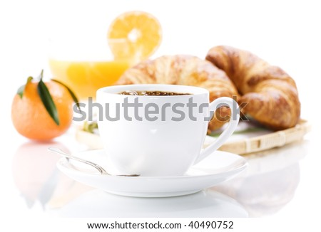 Breakfast with croissants, coffee and orange juice.