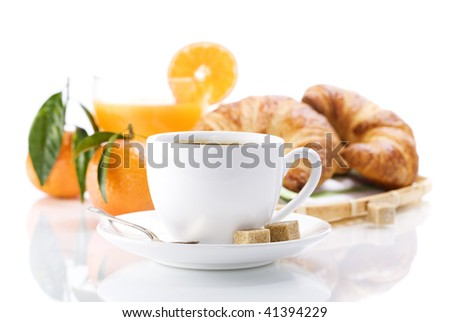 Breakfast with croissants, coffee and orange juice