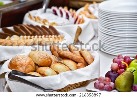 Breakfast with different kinds of breads and fruits