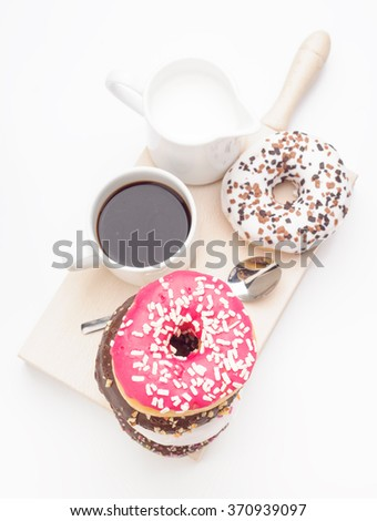 breakfast with donuts on kitchen table isolated on white