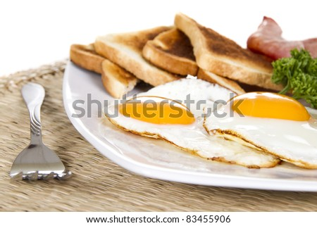 Breakfast with eggs bacon beans and toasts - stock photo