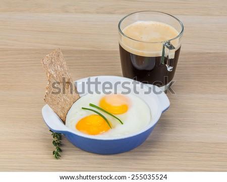 Breakfast with eggs, crisp and coffee espresso - stock photo