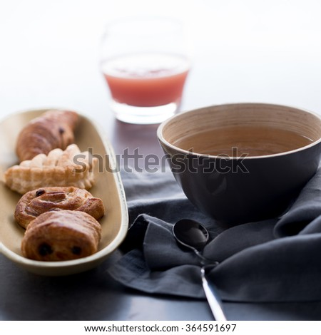 Breakfast with french pastries, tea and guava juice
