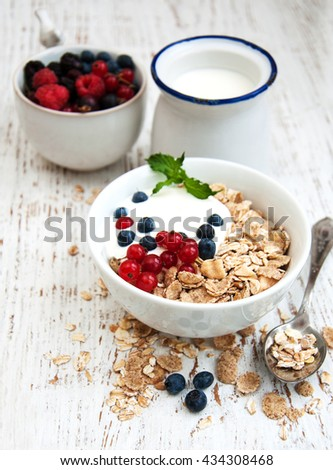 breakfast with fresh berries on a old wooden table - stock photo