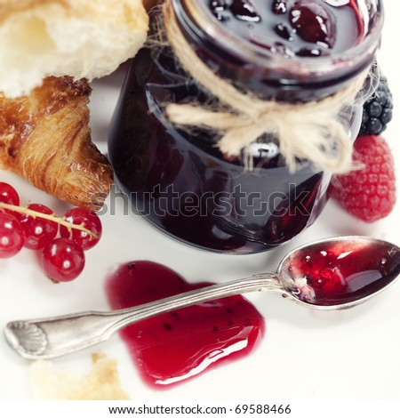 Breakfast with Fresh Croissants and jam (in the shape of heart) - stock photo