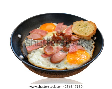 Breakfast with Fried eggs and bacon in pan on white background - stock photo