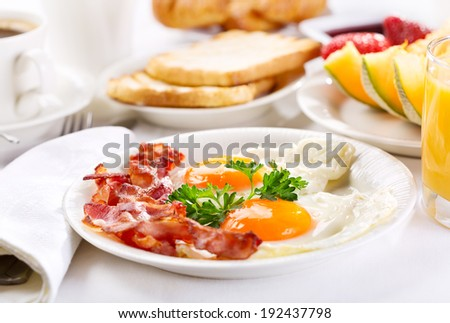 Breakfast with fried eggs, coffee, orange juice, toasts  and fruits - stock photo