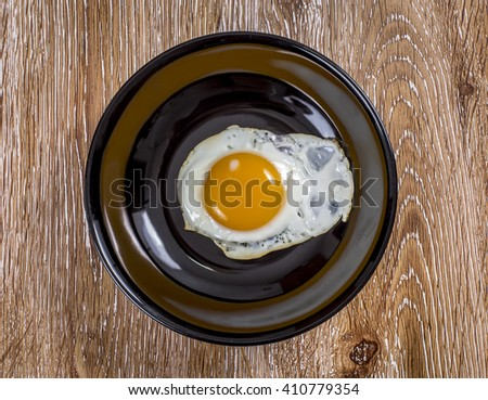 Breakfast with fried eggs  on wooden background - stock photo