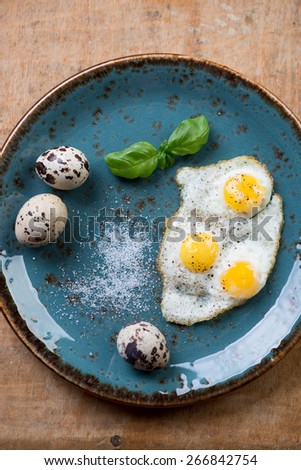 Breakfast with fried quail eggs, view from above, close-up - stock photo