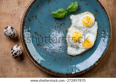 Breakfast with fried quail eggs, view from above, studio shot - stock photo