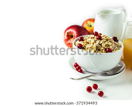 Breakfast with granola and fresh berries on white with free text space. Selective focus.