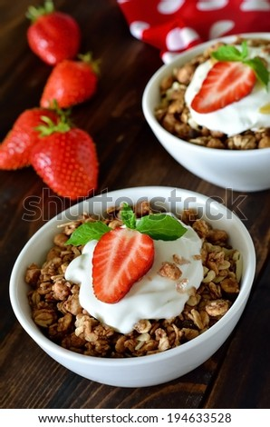 Breakfast with granola and fresh strawberry - stock photo