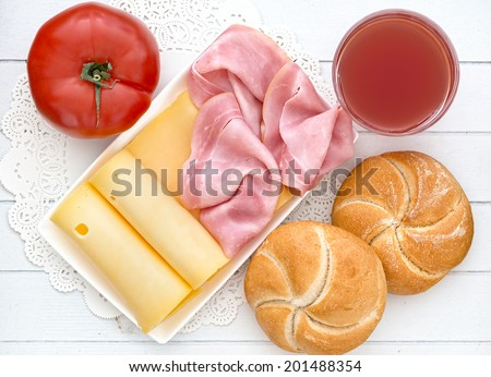 Breakfast with ham and cheese - stock photo
