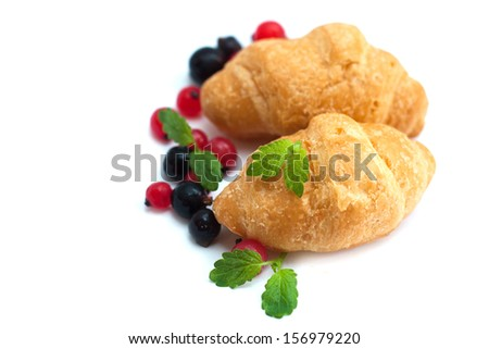 Breakfast with mint, fresh berries and croissants