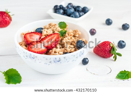 Breakfast with muesli and berries