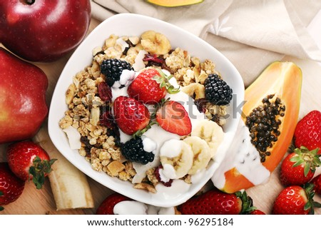 Breakfast with muesli and fresh fruits - stock photo