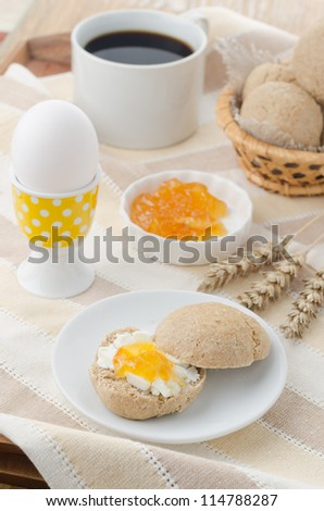 breakfast with muffin, cheese, jam and egg