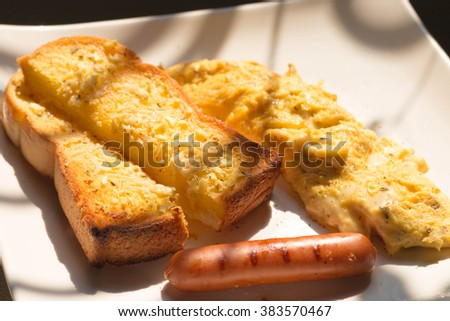 Breakfast with omelet,sausage,garlic bread. select focus