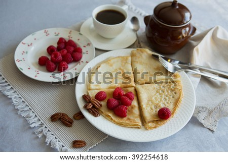 Breakfast with pancakes and raspberry