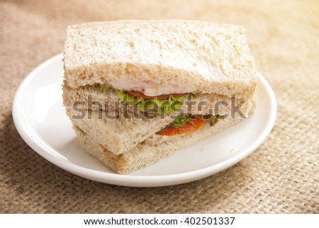 Breakfast with sandwich on gunny sack background