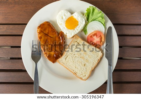Breakfast with steak and fried egg