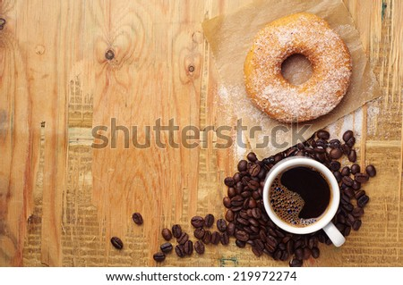 Breakfast with sweet donut and coffee on wooden table. Top view - stock photo