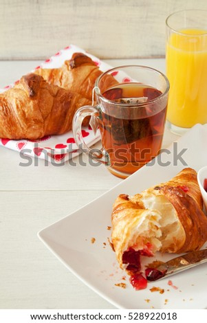 Breakfast with tea and croissants