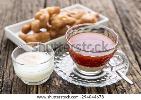 Breakfast with tea , soft boiled egg and  deep-fried dough stick on wooden table,selective focus - stock photo
