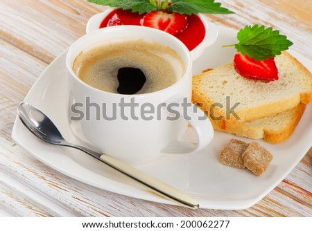 Breakfast with toast, strawberry jam and hot coffee. Selective focus