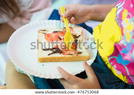 Breakfast with Toasts, Butter, Raspberry Jam on dish, Strawberries, Blueberries on White Background, selective focus