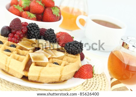 Breakfast with waffle and fruits - stock photo