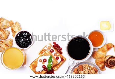 breakfast with waffles, croissants, coffee and juice. place for text